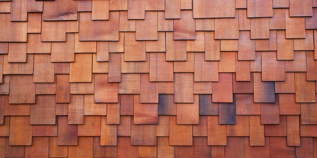 bigstock_33212171_new-section-of-a-red-shake-cedar-or-redwood-roof